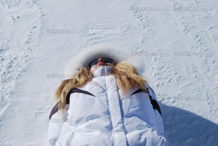 woman lying on a snow