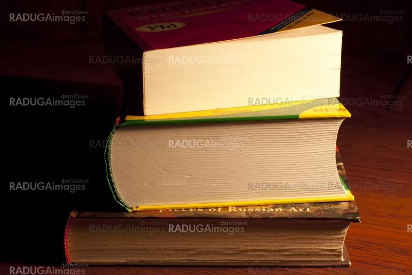 A stack of thick books
