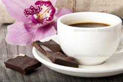 cup of coffee, chocolate and orchid on wooden background