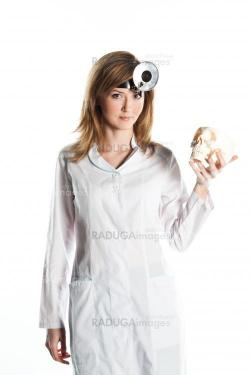 Female doctor with a human skull in his hands