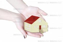 The house in human hands isolated in white