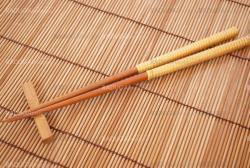 Chopsticks on bamboo matting background