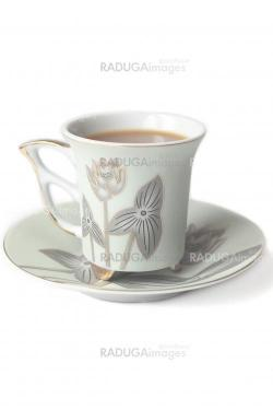cup of coffee with milk or cream and saucer