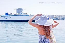 The girl on the background of the ocean liner