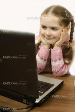 a girl looking at the computer screen