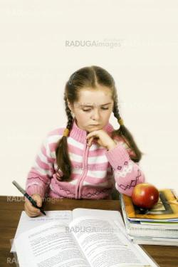 A girl is studying for an important test
