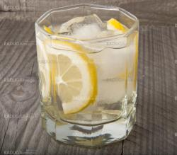 Lemon Cocktail on a wooden background