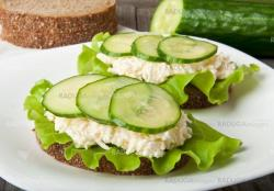 Healthy sandwich with cucumber and egg with cheese for breakfast
