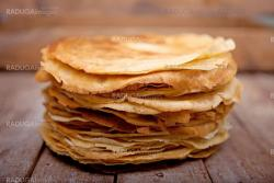 Crepes on the wooden table
