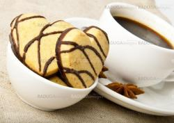 cup of coffee and cookies in a heart-shaped chocolate